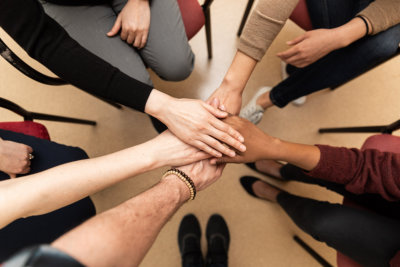 a group of people hands in the center