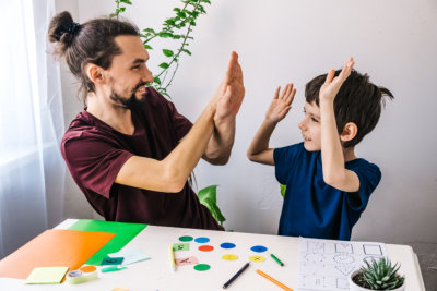happy autism boy during home therapy