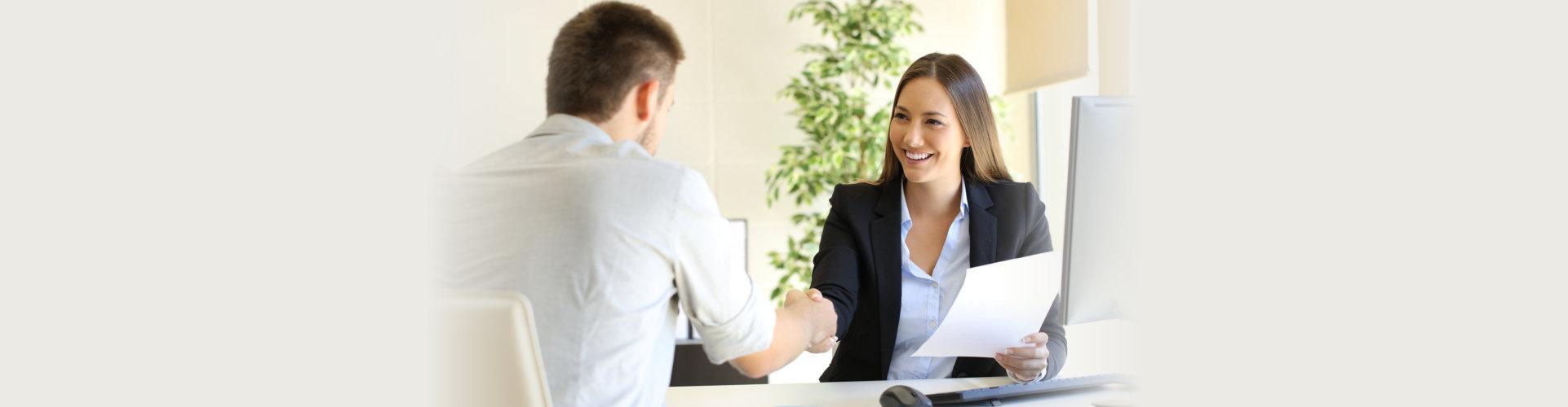 a successful job interview boss employee handshaking